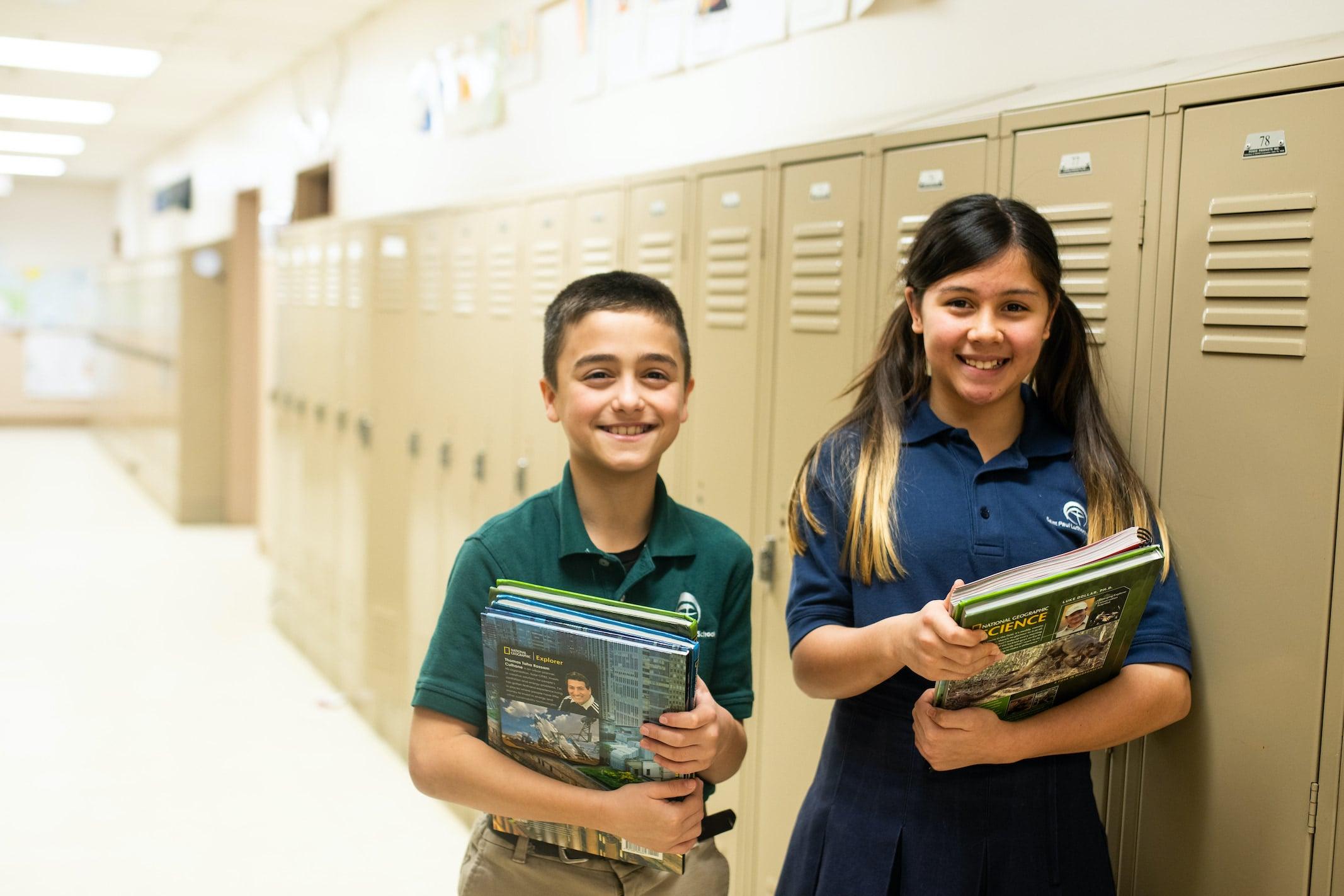 kids holding books in school